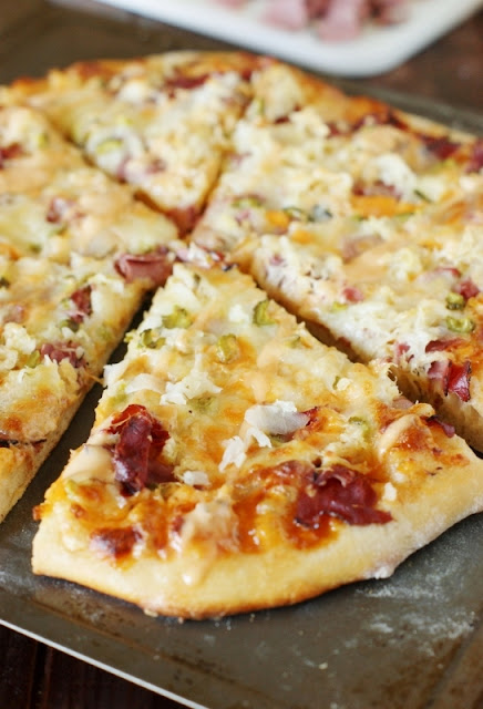 Reuben Pizza ~ enjoy the wonderful flavors of the classic-favorite sandwich in scrumptious pizza form!