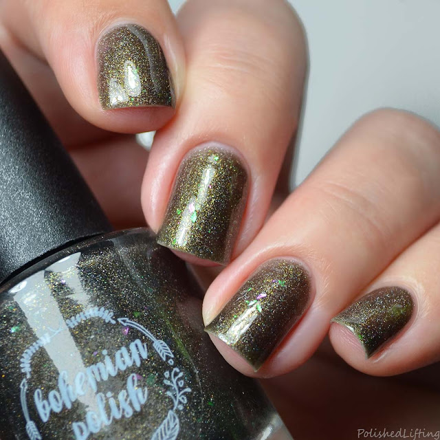 black nail polish with gold shimmer