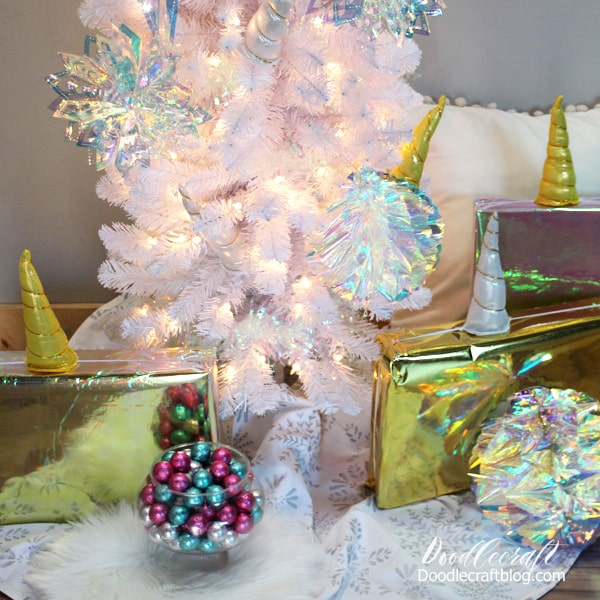 Wrap gifts with Unicorn plush headbands to match a Unicorn Christmas Tree with Iridescent Decorations from Oriental Trading