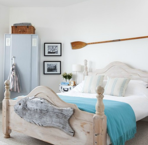 Coastal Bedroom with Rustic Wood Bed