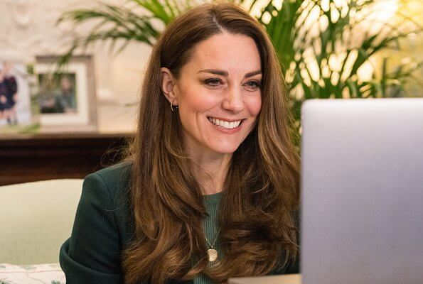 Kate Middleton wore a green wool suit blazer and sweater from Massimo Dutti, and personalized gold midnight moon necklace from Daniella Draper