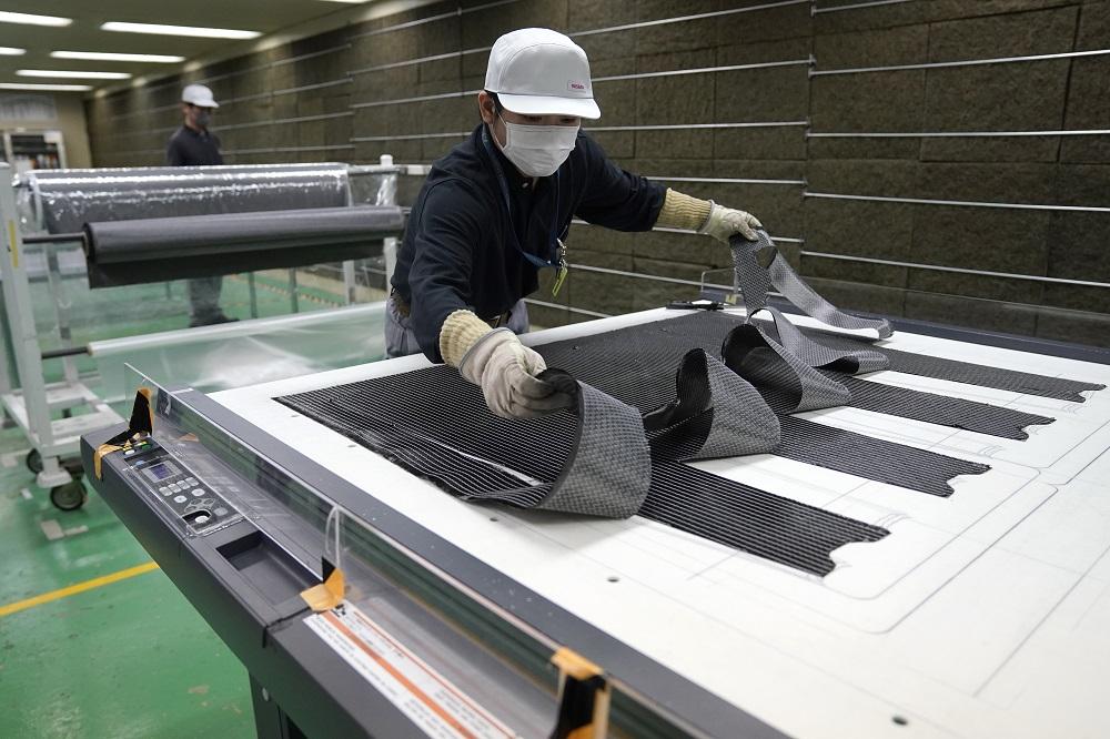Nissan achieves breakthrough in carbon fiber parts production