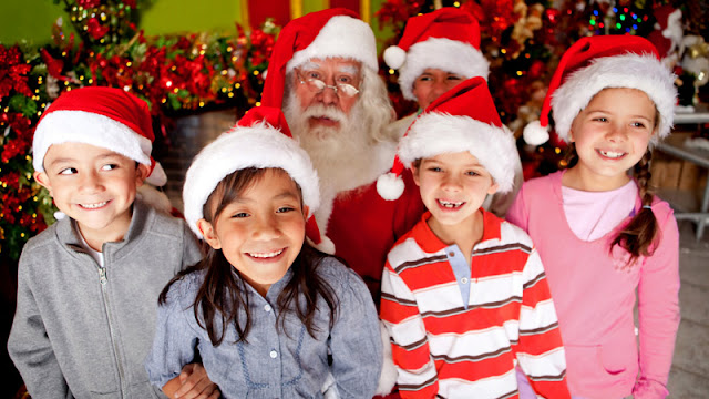 Santa with smiling children in Santa hats