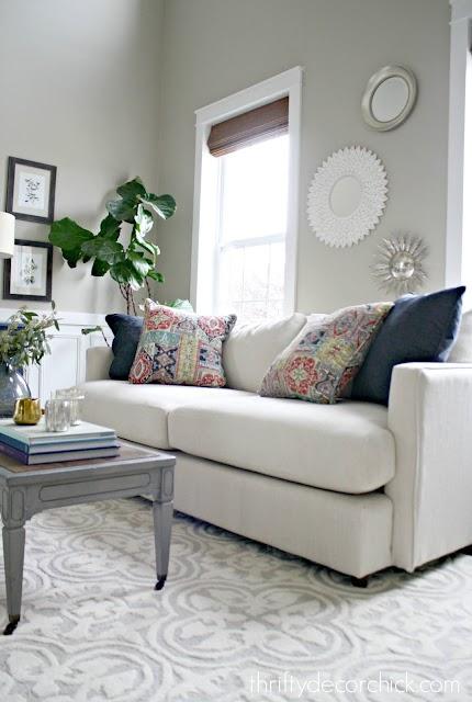 Cream modern sofa colorful pillows