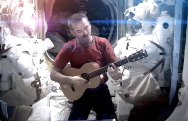 astronaut playing guitar in space - photo #22