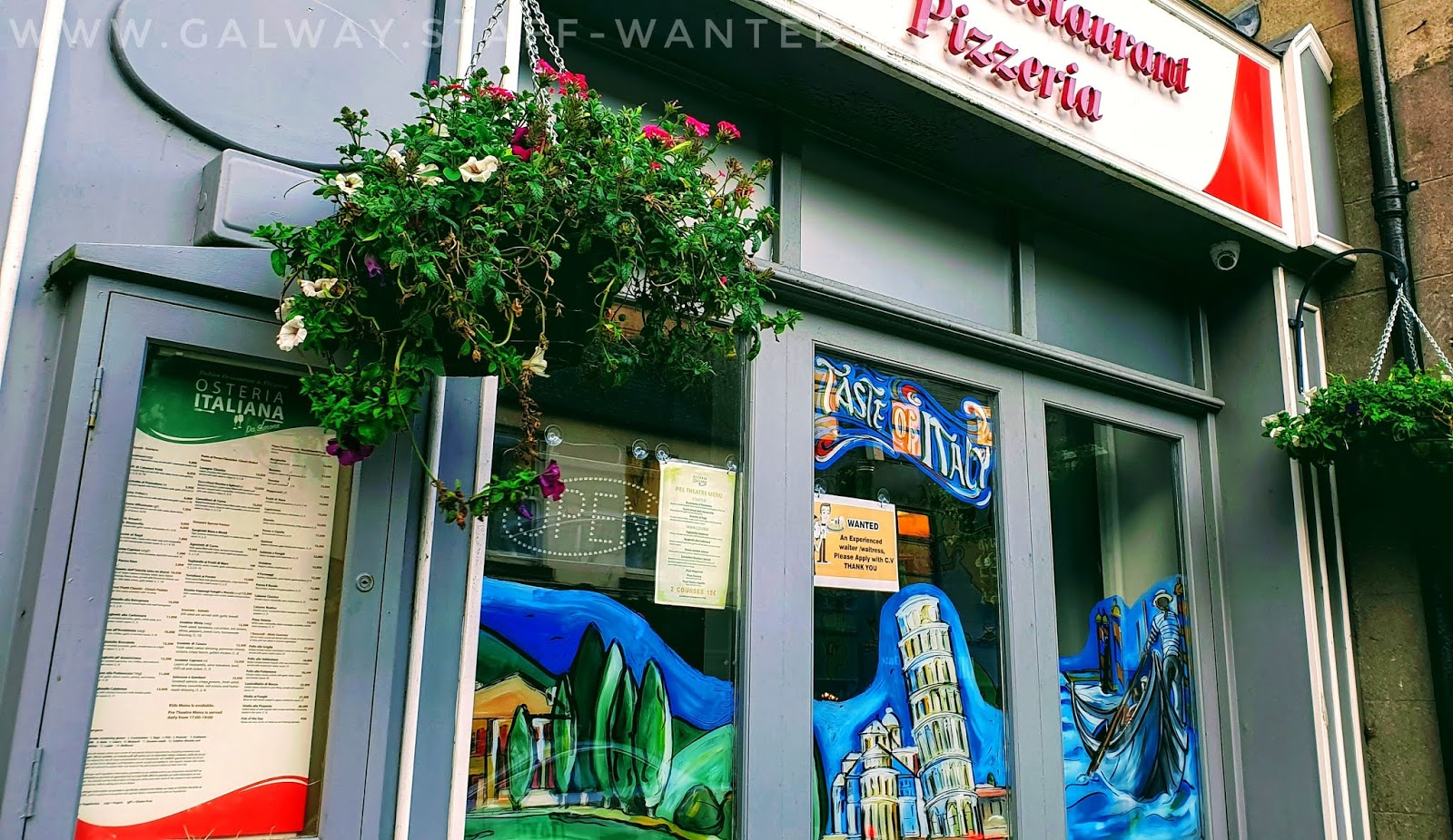 Front window of Irish Italian restaurant, with a stylised leaning tower of Pizza.  Full Simone menu is also shown.