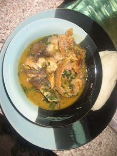 WHITE SOUP IN A PLATE WITH POUNDED YAM