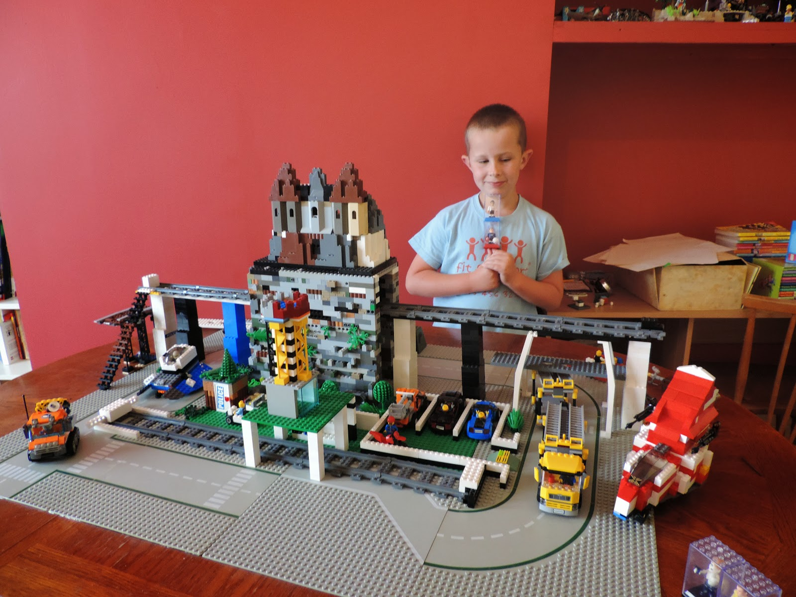 lego castle on top of mountain with train tunnel