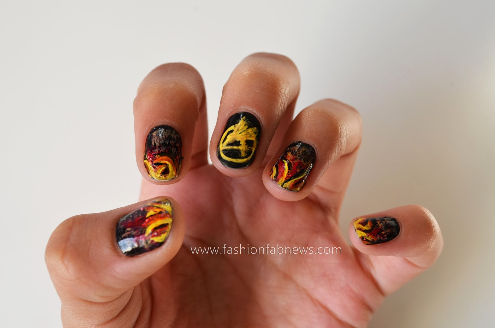 Fashion fab news fashion beauty celebrities designers 2013 hunger games nail art catching fire solutioingenieria Gallery