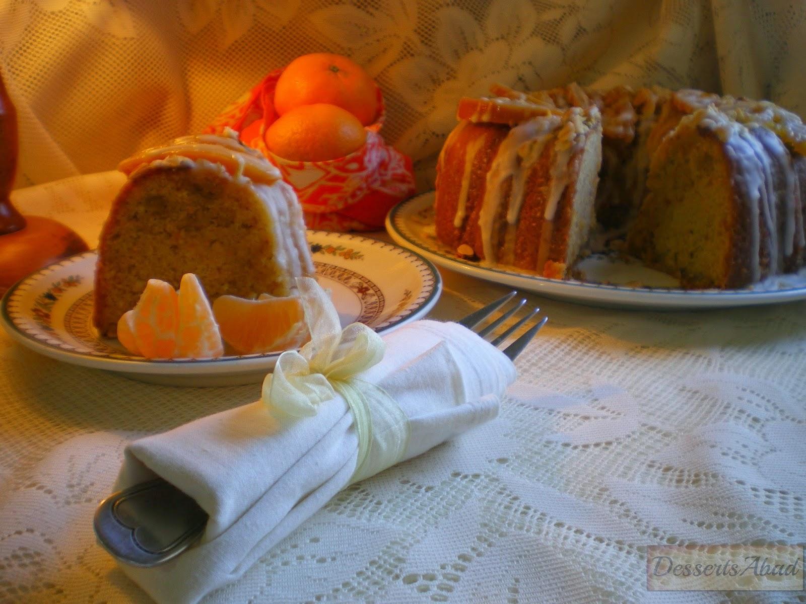 Bizcocho glaseado de mandarinas con almendras y avellanas