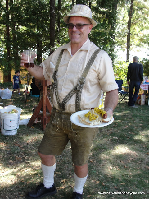 attendee in lederhosen at Oktoberfest Festival in Sierra City, California