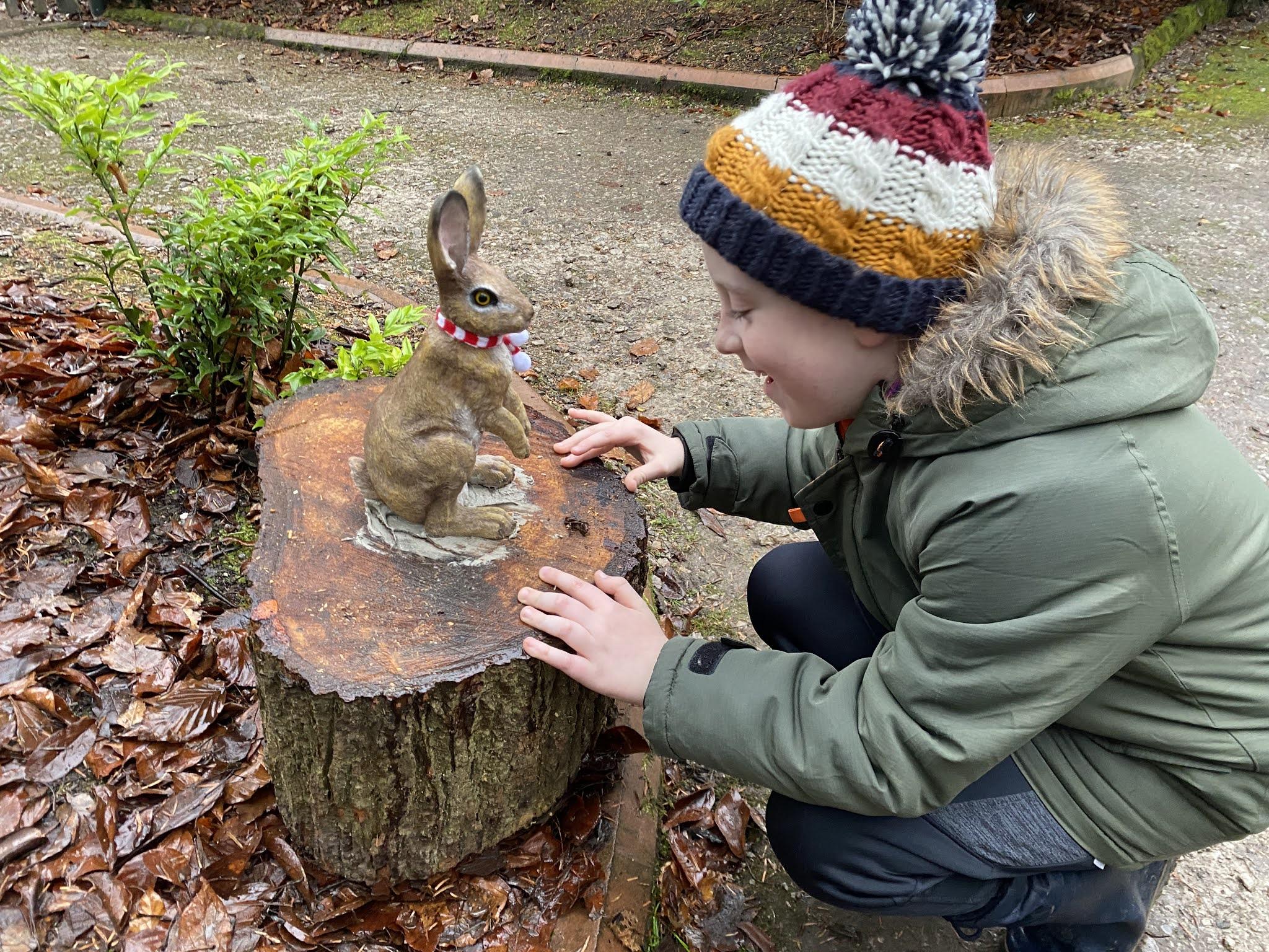 boy with rabbit statue
