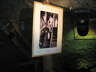 Picture of miners taking the slide
