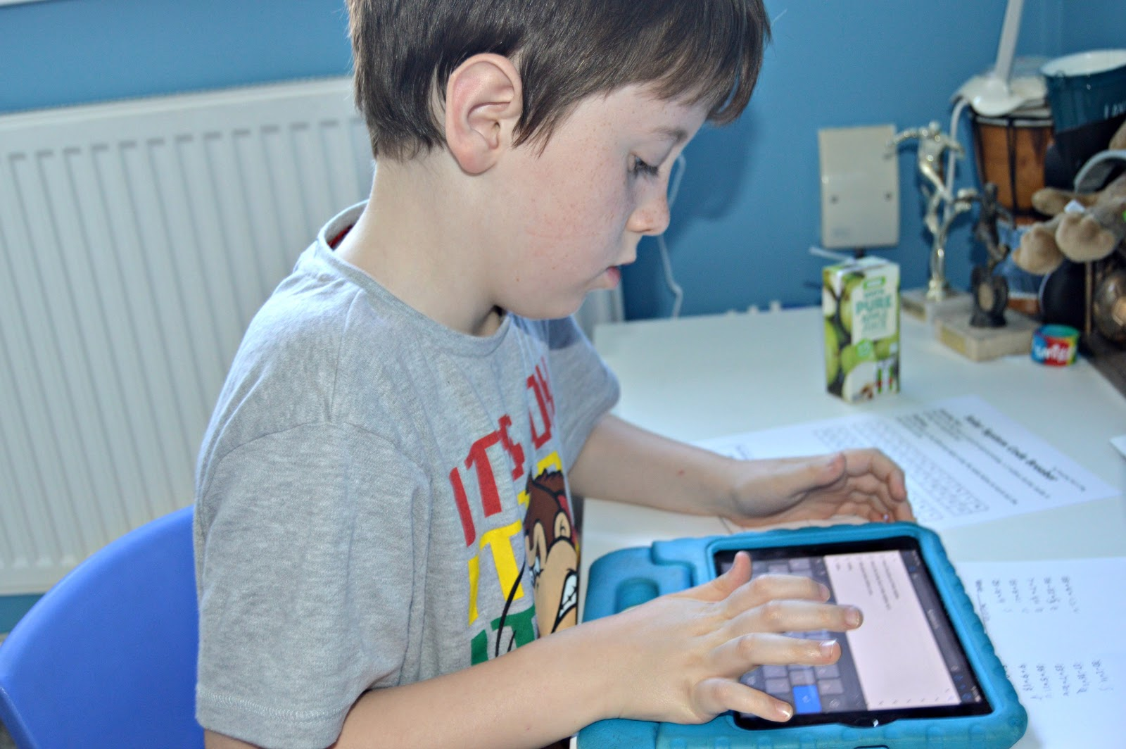 boy playing on an iPad