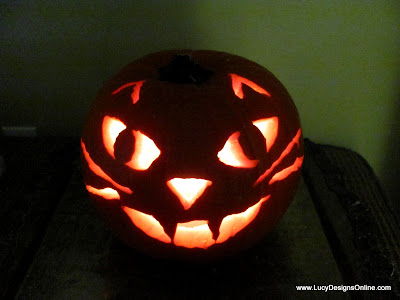 cat face carved pumpkin