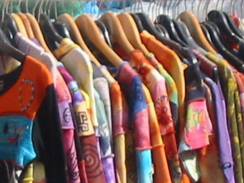 bright clothing hanging on a rail