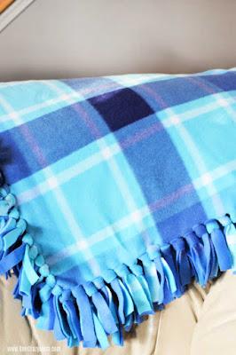 shades of blue fleece blanket with fringe.