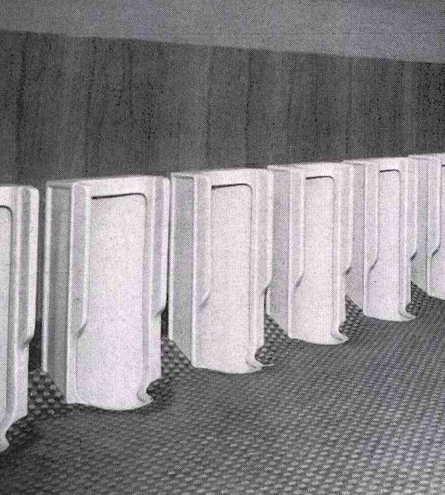 a photograph of 1949 public urinals