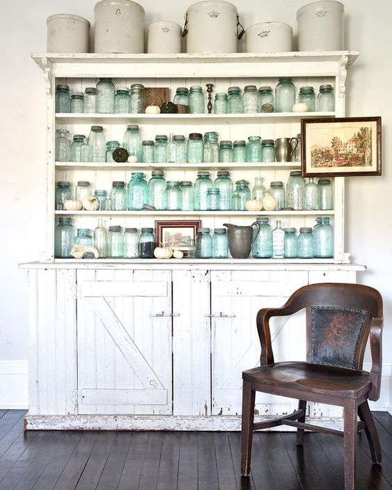 Vintage blue mason jars in a chippy hutch are a beautiful reminder of the past