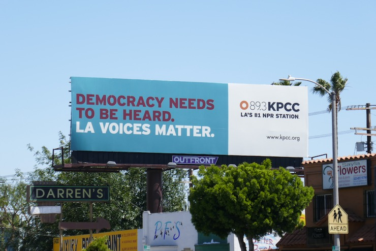 Democracy needs to be heard billboard
