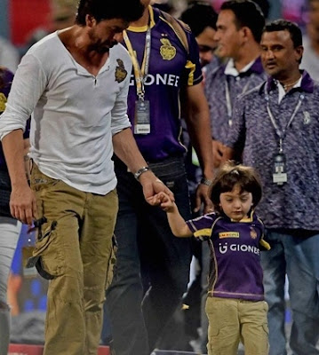SRK attends KKR match with son, showers kisses on fans