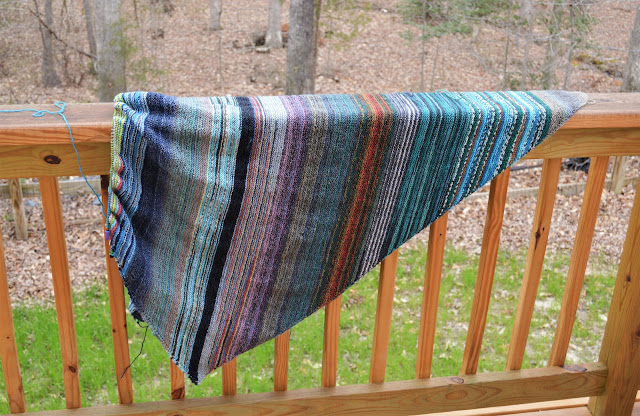 Knitting a diagonally striped blanket with scrap yarn.  https://www.ravelry.com/projects/jeanniegrayknits/kroy-blanket