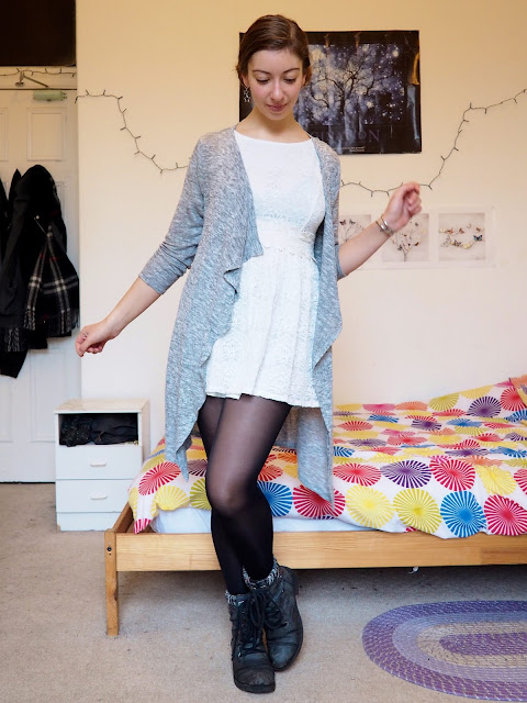 Princess Leia Star Wars Disneybound outfit of white dress, grey cardigan, and black tights & biker boots