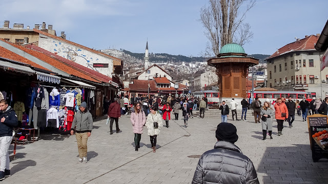 Many people walk through Sarajevo
