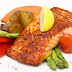 CHEF'S SIGNATURE DISH:  Grilled Salmon with Creamy Paprika Sauce