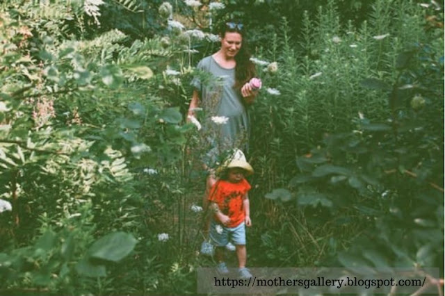 Mother and Son Walking in the Forest Image