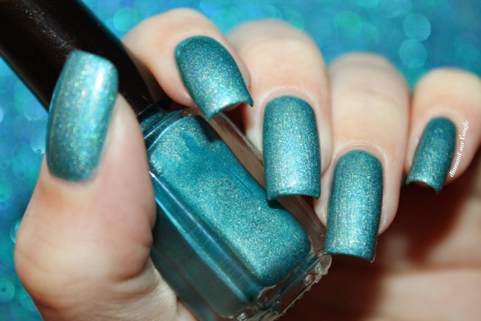 Swatch of a teal holographic franken nail polish