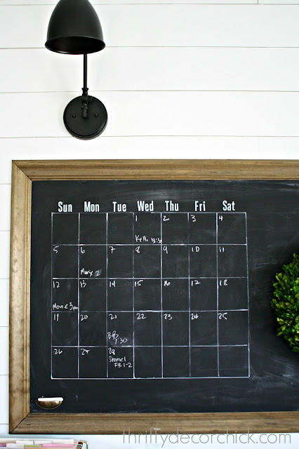 DIY wall calendar on chalkboard wall