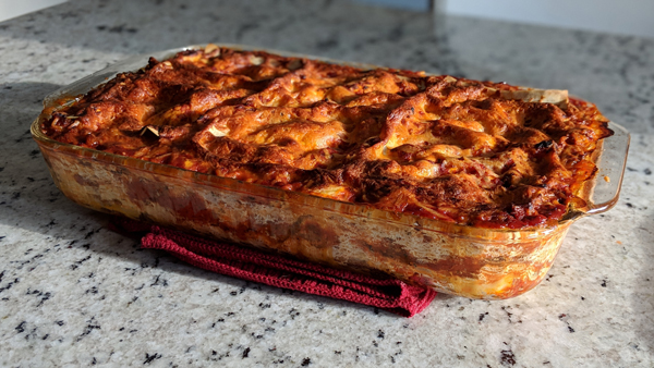 image of a lasagna fresh out of the oven, sitting on my kitchen counter
