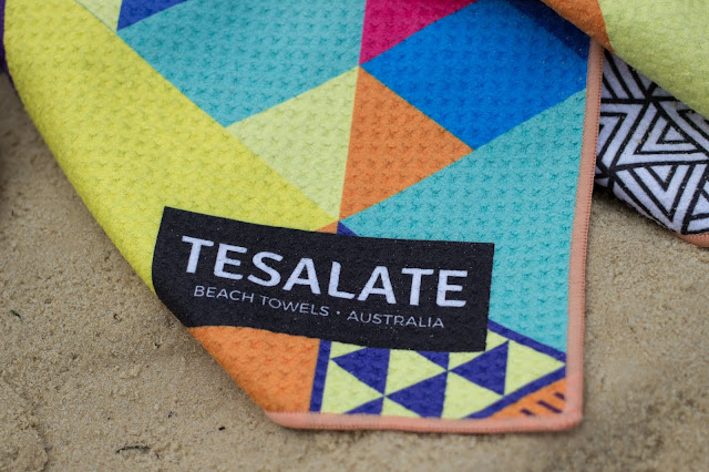 A close up of the Tesalate towel and logo