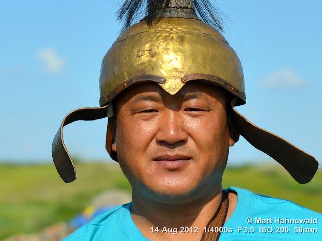 people, portrait, headshot, street portrait, Mongolia, Karakorum, Mongolian man, Chinggis-Khaan-style helmet