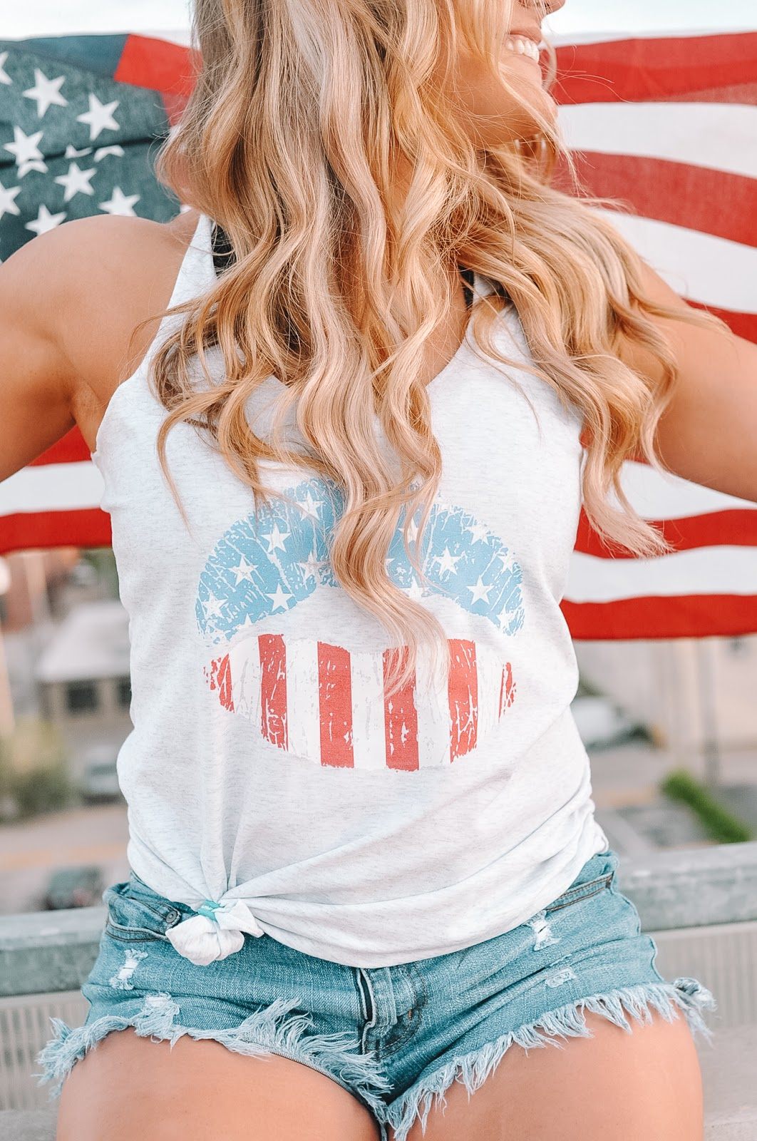 Oklahoma Blogger Amanda Martin wearing a patriotic tee from Pink Lily Boutique