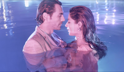 Arjun Rampal as Rahul Verma and Chitrangada Singh as Maya Luthra, getting cozy in the swimming pool, Directed by Sudhir Mishra