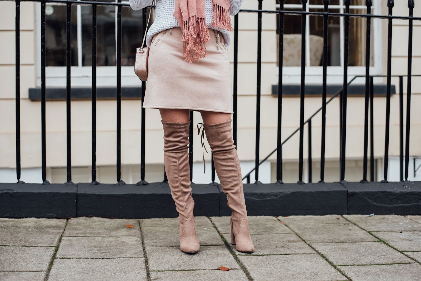 Close Up Detail Shot of Over the Knee Boots with Pink Sueded Skirt