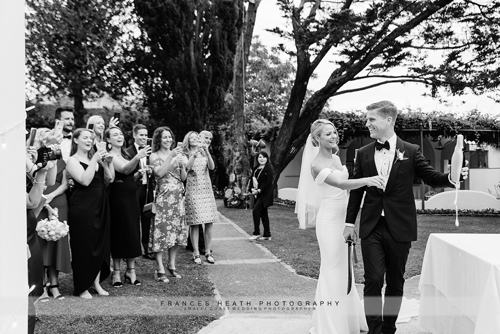 Guests applauding groom with sciabala