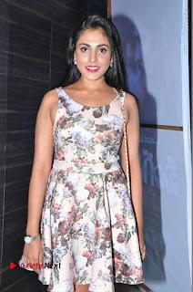 Actress Madhu Shalini Stills in Floral Short Dress at RGV Shiva to Vangaveeti Event  0079.JPG