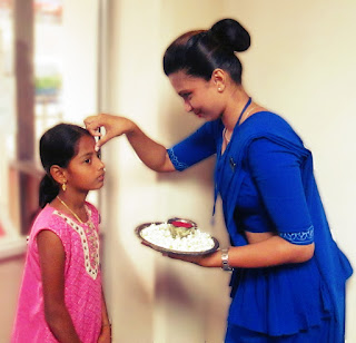 A young passenger greeted in a traditional style at the inaugural flight to Chennai