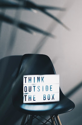 Sign that says 'Think outside the box'