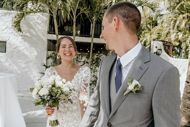 Bride and Groom smiling and looking at each other with Bride holding white bouquet The Manor on St Lucie Crescent Wedding captured by Stuart Wedding Photographer Heather Houghton Photography