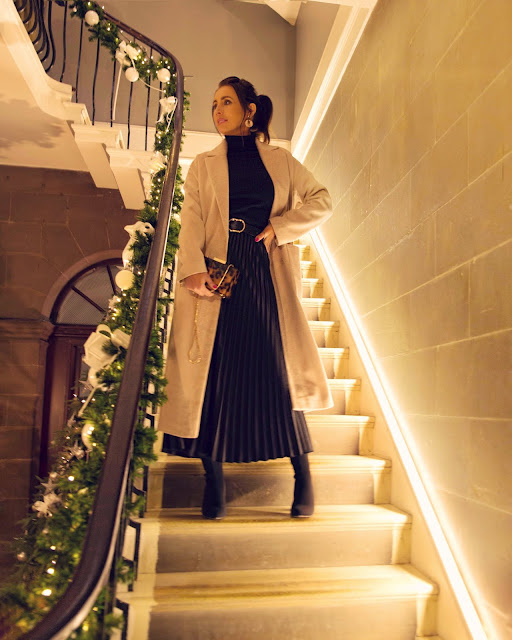 woman in classic outfit on stairs