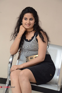 Actress Ankitha Stills in Short Dress at Kali Movie Audio Launch 0052