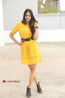 Actress Poojitha Stills in Yellow Short Dress at Darshakudu Movie Teaser Launch .COM 0022.JPG
