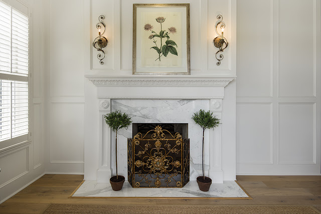 decor fireplace and sconces