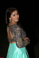 Nikki Galrani in Green Skirt  Top at Marakathamani music launch ~  Exclusive (120).JPG