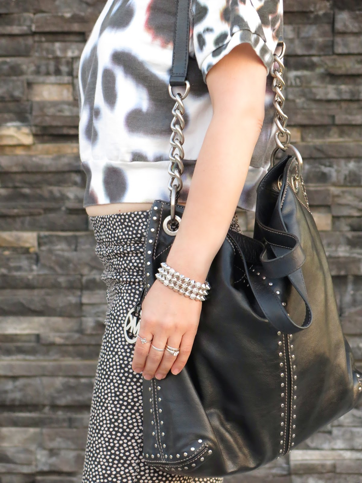 leopard-print cropped sweatshirt, dotted skinnies, and Michael Kors bag