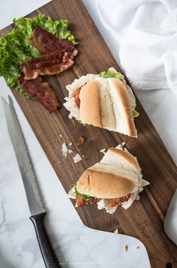 Turkey sub cut in half on cutting board